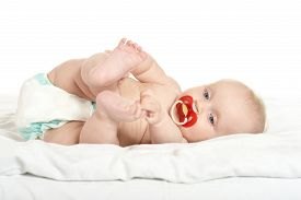 foto of nipples  - Adorable baby girl on blanket with nipple on a white background - JPG