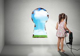 foto of cognitive  - Child girl break wall cognition creative concept - JPG