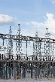 stock photo of substation  - High voltage electric power substation with sky background - JPG