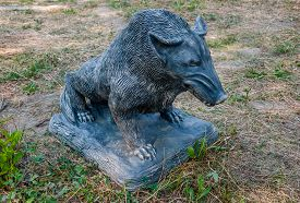 picture of boar  - sculpture of a wild boar on the ground close - JPG