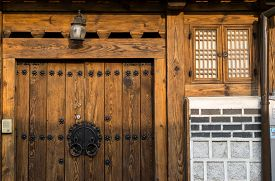 foto of dong  - Traditional korean house front gate with the sunset light - JPG