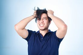 image of frown  - Asian handsome man holding his head frowning with worry screaming - JPG