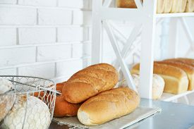 picture of bakeshop  - Bread on shelves in store - JPG