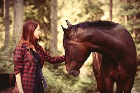 picture of horse girl  - Redhead girl with horse in the forest - JPG