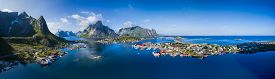 picture of reining  - Scenic aerial panorama of fishing town Reine and surrounding fjords on Lofoten islands in Norway famous for its breathtaking scenery