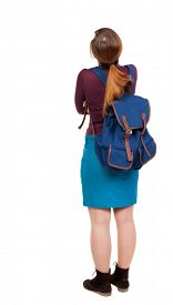 foto of up-skirt  - Back view of  woman with backpack looking up - JPG