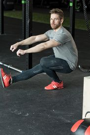 picture of pistols  - Man doing cross fit exercise  - JPG