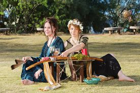 picture of sabbatical  - Pair of beautiful pagan women at outdoor altar - JPG