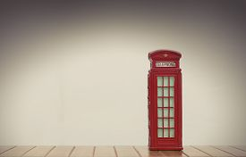 picture of phone-booth  - vintage red british phone booth souvenir on white background - JPG