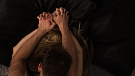 image of hand kiss  - Passionate couple making love and holding hands - JPG
