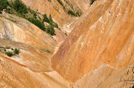 stock photo of ravines  - Deep ravine with geological clay and sandstone layers - JPG