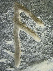 picture of rune  - pagan rune ansuz carved in the stone - JPG