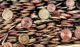 stock photo of homogeneous  - Coins of various countries piled one on the other form a homogeneous composition - JPG