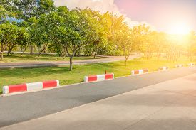 picture of traffic signal  - Jogging track and traffic signal line to know do not entry the garden in public park with sunlight - JPG