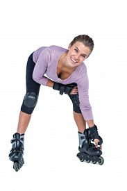 pic of inline skating  - Portrait of happy woman inline skating over white background - JPG