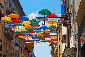 stock photo of nylons  - Urban sun protection design of multicolor nylon umbrellas - JPG