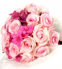 picture of azalea  - Pretty bouquet of fresh pink spring flowers with roses and azaleas for a bride for her wedding Valentines Day anniversary or Mothers Day over white - JPG