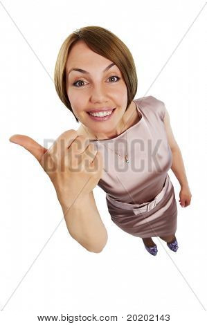 One cheerful positive woman in dress with thumbs up at wide angle view