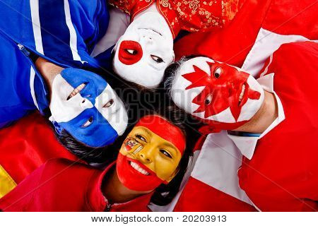 Group of people with flags of different countries painted on their faces