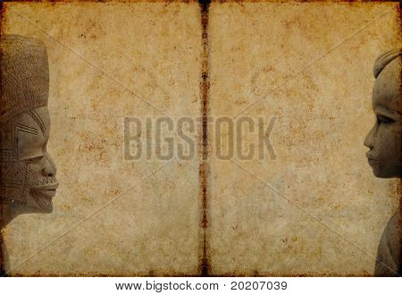 lovely brown background image with interesting texture, profiles of two west african wooden statues and plenty of space for text