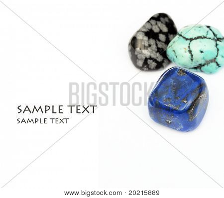 three beautiful precious stones against white background