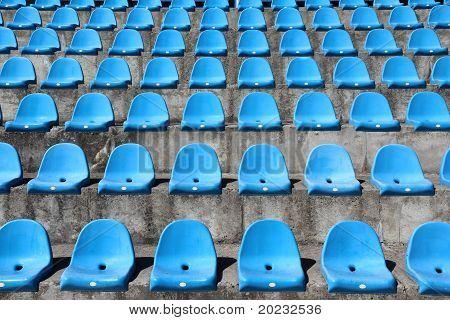 Old Plastic Blue Seats On Football Stadium
