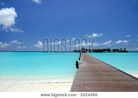 Footbridge Over Turquoise Ocean On An Maldivian Island
