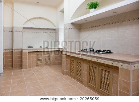 New empty modern kitchen with gas stove in a new house