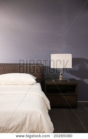 Modern bed room interior -- Lamp and pillows in a new house