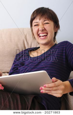 Young woman surfing the web with a tablet  and reading ebook