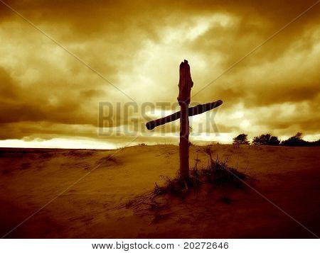 Wooden cross in the dune
