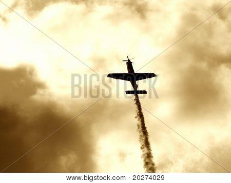 A plane making the smoke way. Toned