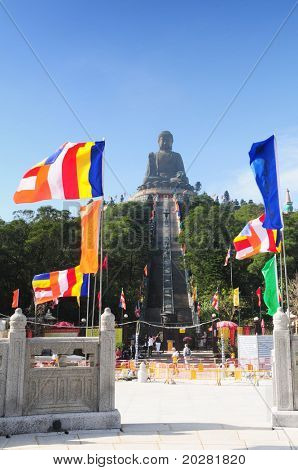 Tian Tan Buddha - The worlds's tallest bronze Buddha in Lantau Island, Hong Kong, China with colorfull flags