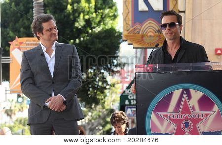 HOLLYWOOD - JAN 13: Colin Firth (l) listens to  Guy Pearce speak at the ceremony for Firth as he receives his star on the Hollywood Walk of Fame  on January 13, 2011 in Hollywood, CA