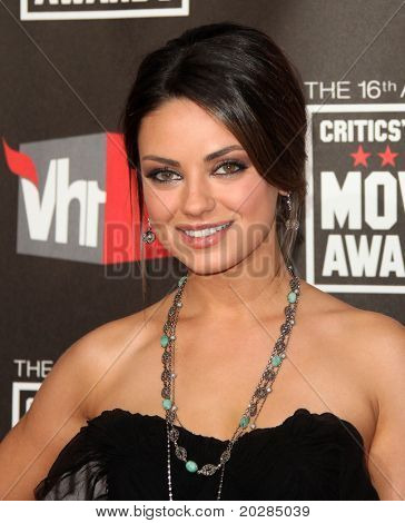 LOS ANGELES - JAN 14:  Mila Kunis arrives at the 16th Annual