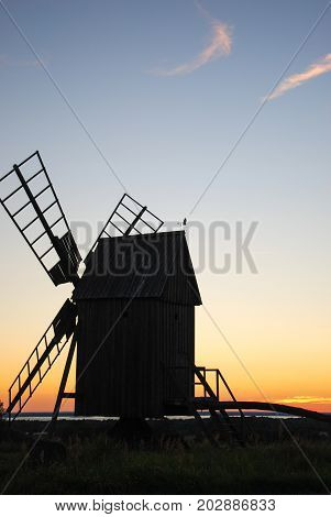 Traditional wooden windmill by sunset at the swedish island Oland