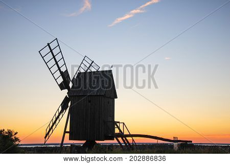 Old wooden windmill by sunset at the swedish island Oland