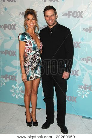 PASADENA, CA - JAN 11:  Natalie Zea & Travis Schuldt arrive at the FOX All-Star Party on January 11, 2011 in Pasadena, CA