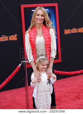 "LOS ANGELES - MAR 06:  Taylor Armstrong & Kennedy arrives at the ""Mars Needs Moms"" World Premiere  on March 06, 2011 in Hollywood, CA"