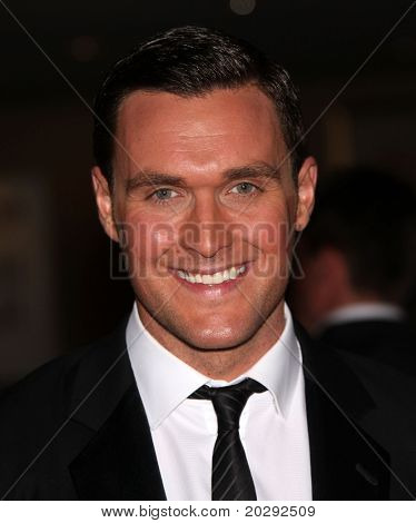 LOS ANGELES - MAR 19: Owain Yeoman arrives to the 25th Annual Genesis Awards  on March 19, 2011 in Century City, CA