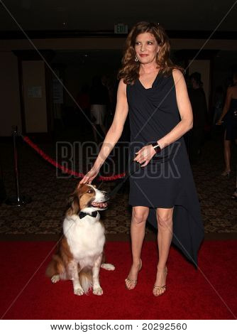 LOS ANGELES - MAR 19:  Rene Russo & Dusty arrives to the 25th Annual Genesis Awards  on March 19, 2011 in Century City, CA