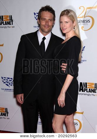 LOS ANGELES - MAR 19:  Michael Vartan & Date arrives to the 25th Annual Genesis Awards on March 19, 2011 in Century City, CA