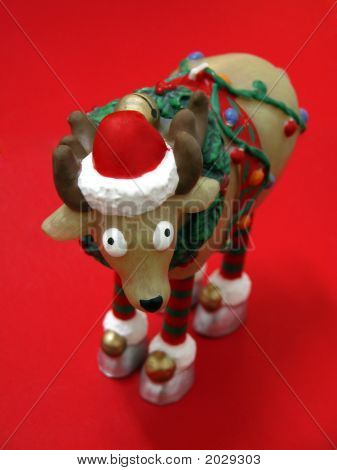 Christmas Reindeer in Santa Claus costume