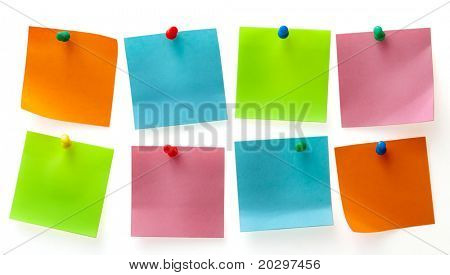 A different color post-it-note and pins isolated on white background