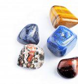 stock photo of lapis lazuli  - beautiful precious stones against white background - JPG