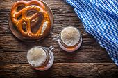 Beer And Oktoberfest. Draft Beer Pretzel And Blue Checkered Tablecloth As Traditional Products For B poster