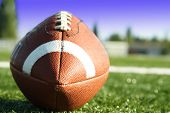 picture of football field  - A shot of an american football on a football field - JPG