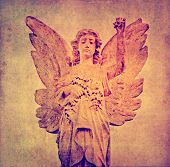 image of cherubim  - earthy background image with sculpture of an angel - JPG