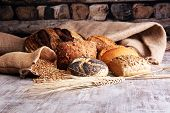 Different Kinds Of Bread And Bread Rolls On Board. Kitchen Or Bakery Poster Design. poster
