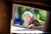Happy Little Boy Having Fun On Outdoor Playground poster